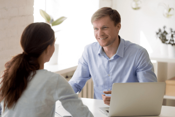 Woman Getting Advice From A Real Estate Investor